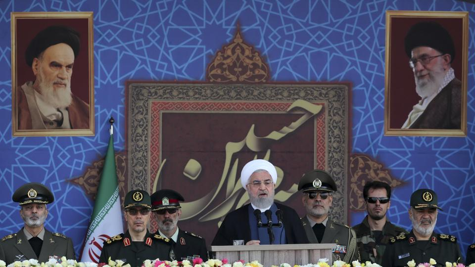 In this photo released by the official website of the office of the Iranian Presidency, President Hassan Rouhani speaks at a military parade marking 39th anniversary of outset of Iran-Iraq war, in front of the shrine of the late revolutionary founder Ayatollah Khomeini, just outside Tehran.