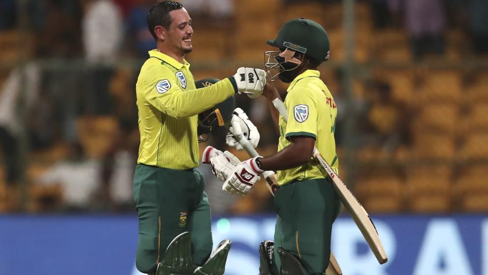 South Africa's captain Quinton de Kock, left, celebrates with his batting partner Temba Bavuma.