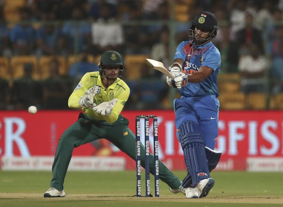 Shikhar Dhawan, right, plays a shot during the third and last T20 cricket match between India and South Africa. (AP)
