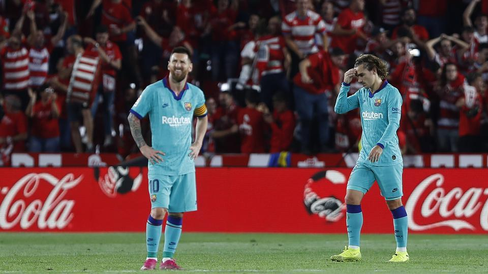 Barcelona's Messi, right, and Antoine Griezmann react.