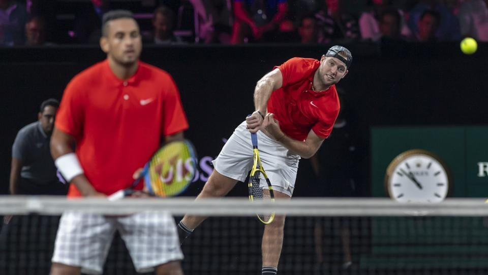 Team World's Nick Kyrgios, left, and Jack Sock play Team Europe's Rafael Nadal and Stefanos Tsitsipas during a doubles tennis match at the Laver Cup tennis event in Geneva on Saturday, Sept. 21, 2019