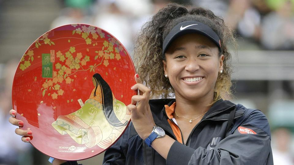 Japan's Naomi Osaka poses for a photo during an award ceremony after winning the Toray Pan Pacific Open tennis tournament.