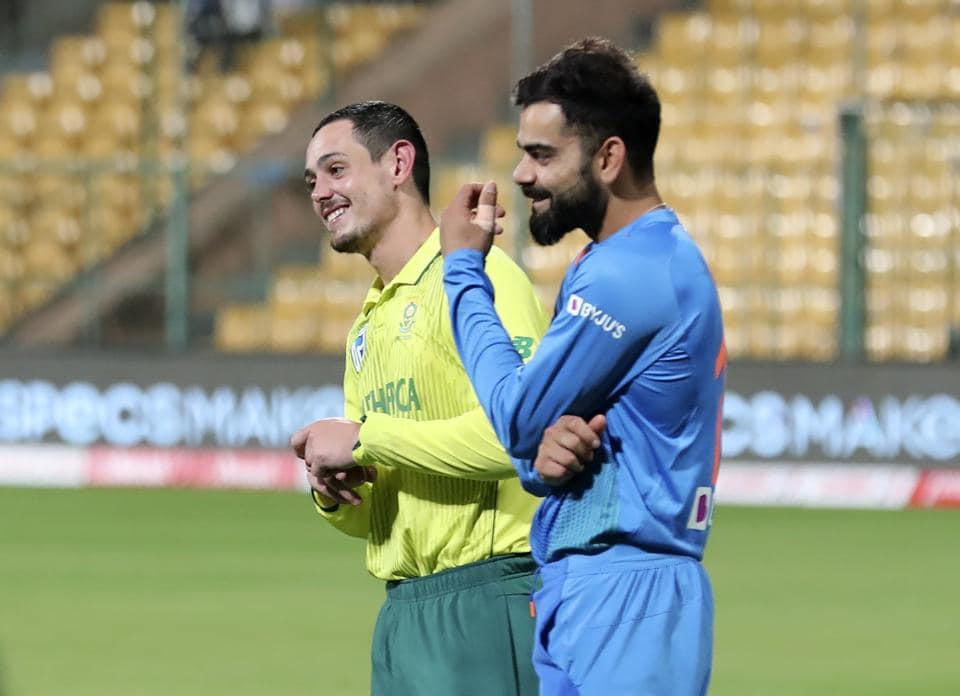 India's captain Virat Kohli and South Africa's captain Quinton de Kock share a light moment during the presentation ceremony. (AP)