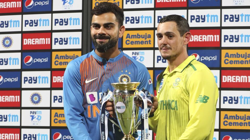 India's captain Virat Kohl and South Africa's captain Quinton de Kock hold the winners trophy after the third and last T20 cricket match. (AP)