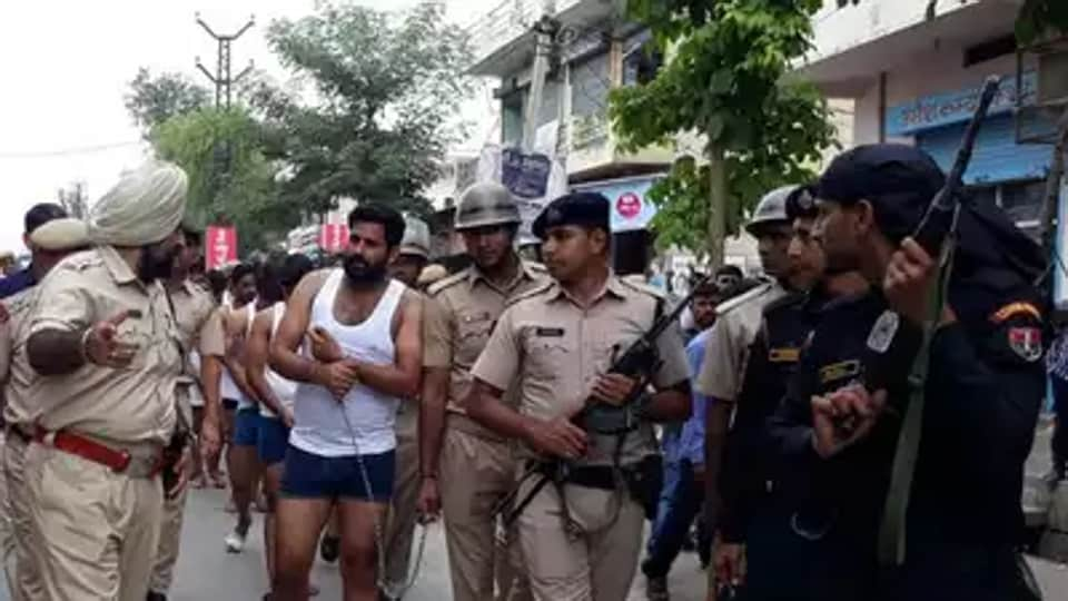 A video of the parading incident that went viral on Sunday, showed that the 13 gangsters taken out in their undergarments were hand-cuffed and made to walk for a kilometre in the crowded marketplace.