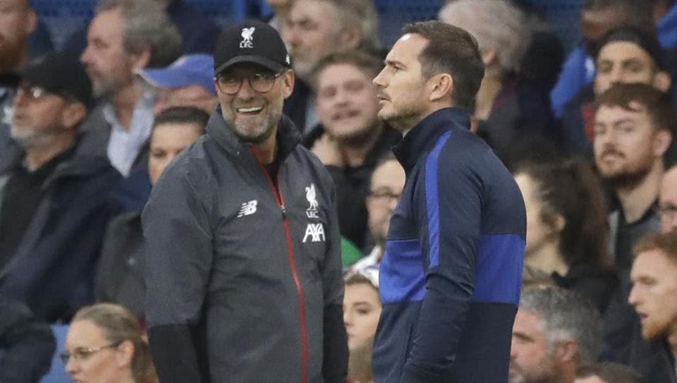 Liverpool's manager Jurgen Klopp, left, salutes Chelsea's head coach Frank Lampard