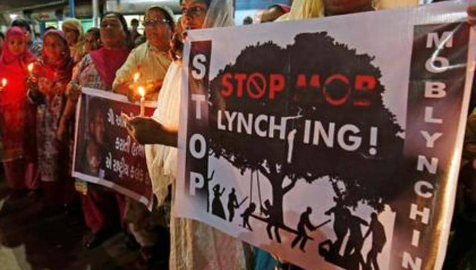 A man died and two others were injured when a mob assaulted them over allegations of cow slaughter.