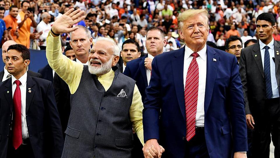 Prime Minister Narendra Modi and President Donald Trump meet at the NRG stadium in Houston on Sunday.