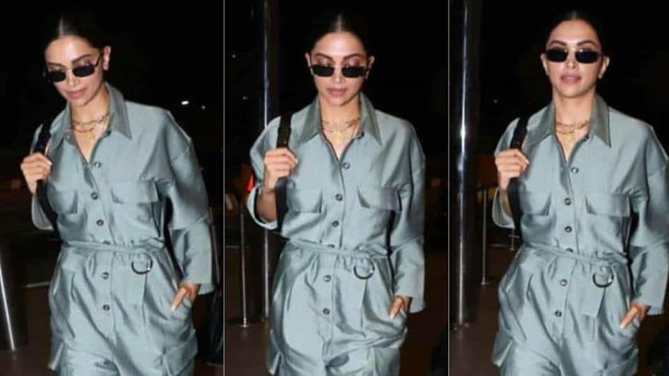 Deepika walked into Mumbai's international airport for her flight to France in a metallic dove grey jumpsuit, with a matching belt.