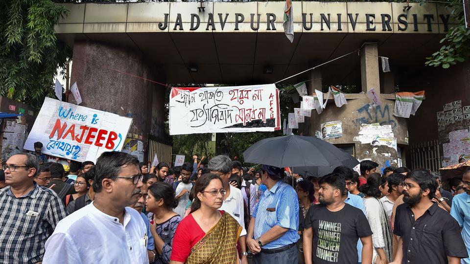 Faculty of Jadavpur University and students stand guard infront of the University gate during Akhil Bharatiya Vidyarthi Parishad (ABVP)'s march in protest against attack on Central Minister Babul Supriyo at Jadavpur University on Monday.