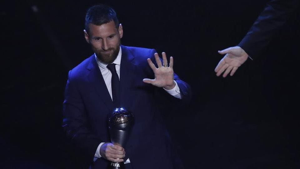 Argentinian Barcelona player Lionel Messi receives the Best FIFA mens player award during the ceremony