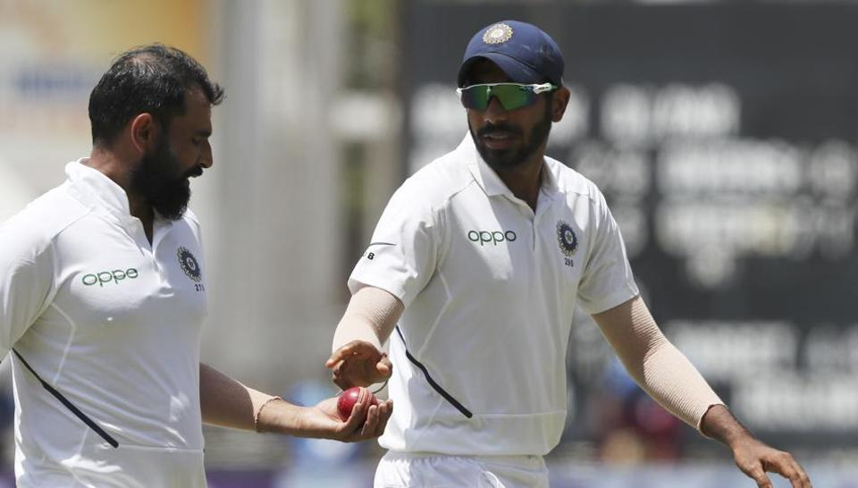 India's Jasprit Bumrah, right, gives the ball to Mohammed Shami during