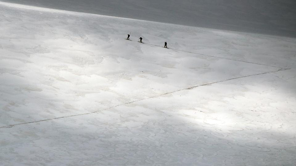 A group of scientists from the Austrian Institute for Interdisciplinary Mountain Research cross the Jamtalferner glacier near Galtuer, Austria. Scientists are racing to read a rapidly melting archive of climate data going back thousands of years - the insides of Austria's Alpine glaciers. (Lisi Neisner / REUTERS)