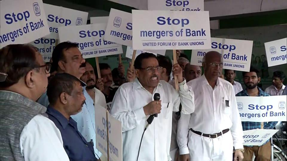 Members of Unions (Delhi State) stage protest against the Bank Merger, in New Delhi last Augurst.