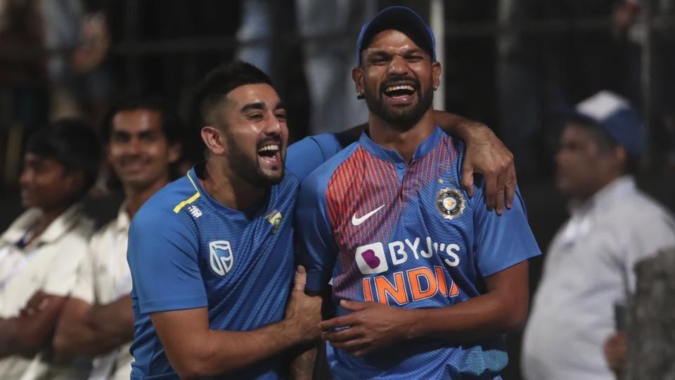 South Africa's Tabraiz Shamsi, left, shares a light moment with India's Shikhar Dhawan.