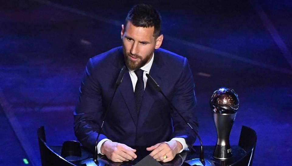Barcelona's Lionel Messi speaks after winning the Best FIFA Men's player award