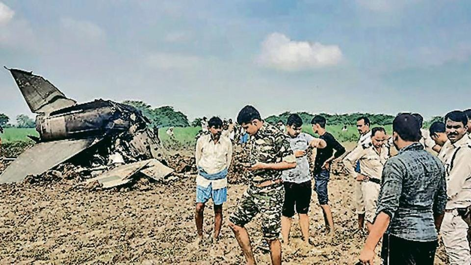 Policemen and locals gather at the site where MiG-21 trainer jet crashed near the Gwalior airbase on Wednesday.