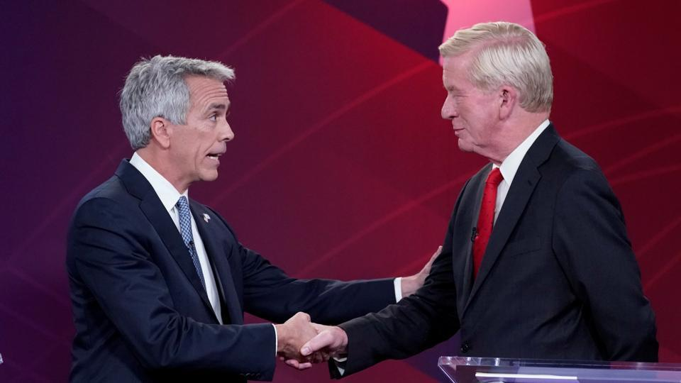 2020 Republican U.S. presidential candidates, former U.S. congressman Joe Walsh (L) and former Massachusetts Governor Bill Weld shake hands at the start of a debate in New York, U.S.