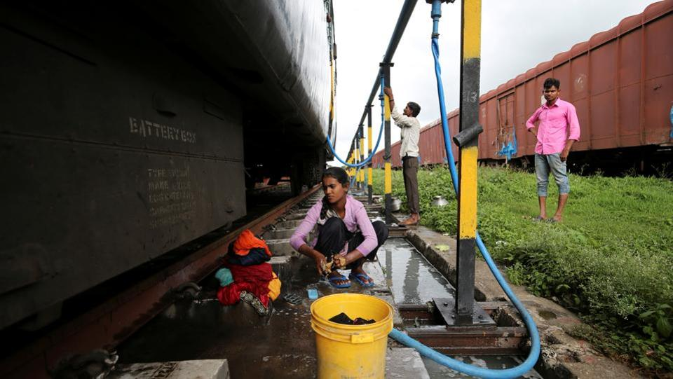 "Anjali Gaikwad, 14, washes clothes at Aurangabad railway station. Gaikwad and her sisters, also board the train every few days to collect water and wash clothes. Their neighbour Prakash Nagre often tags along with soap and shampoo. ""There's no water to bathe at home,"" he said. (Francis Mascarenhas / REUTERS)"