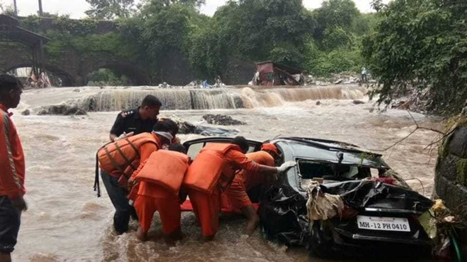 NDRFofficials recovered the body of a man from a car found floating in flood water on Singhnad Road in Pune.
