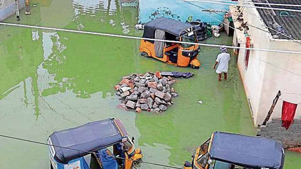 Auto-rickshaws are partially submerged in a flooded street after heavy rainfall in Hyderabad on Wednesday.