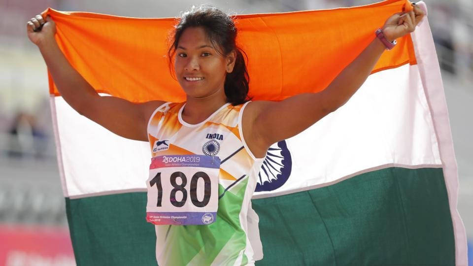 India's Swapna Barman celebrates with national flag after competing in the women's heptathlon.