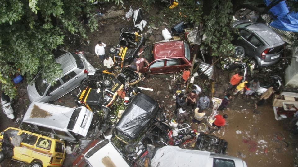 Vehicles are piled up on a street after a flash flood following heavy rains, in Pune.