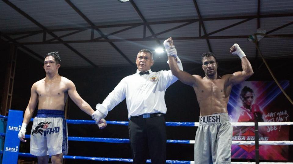 Rajesh 'Lukka' Kasana celebrates victory over Ivor Lastrilla.