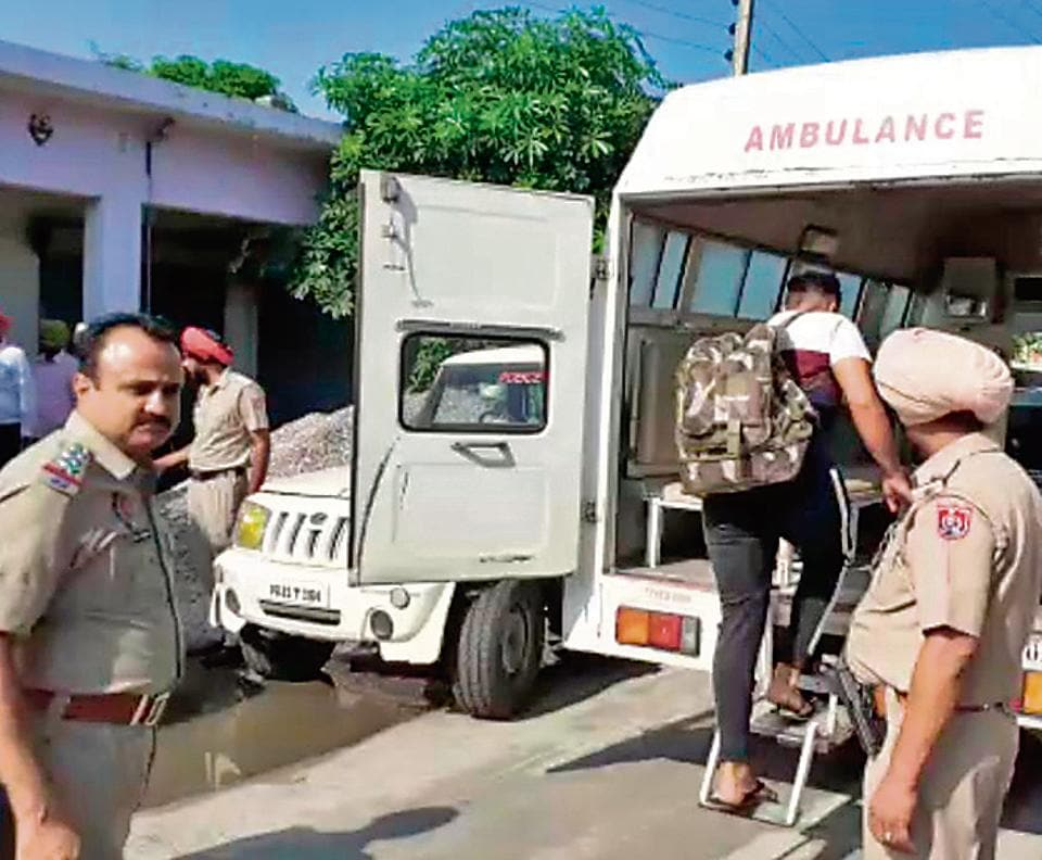 Police rescuing 28 persons from the de-addiction centre at Fatehgarh Neoa village, Fatehgarh Sahib, on Friday.