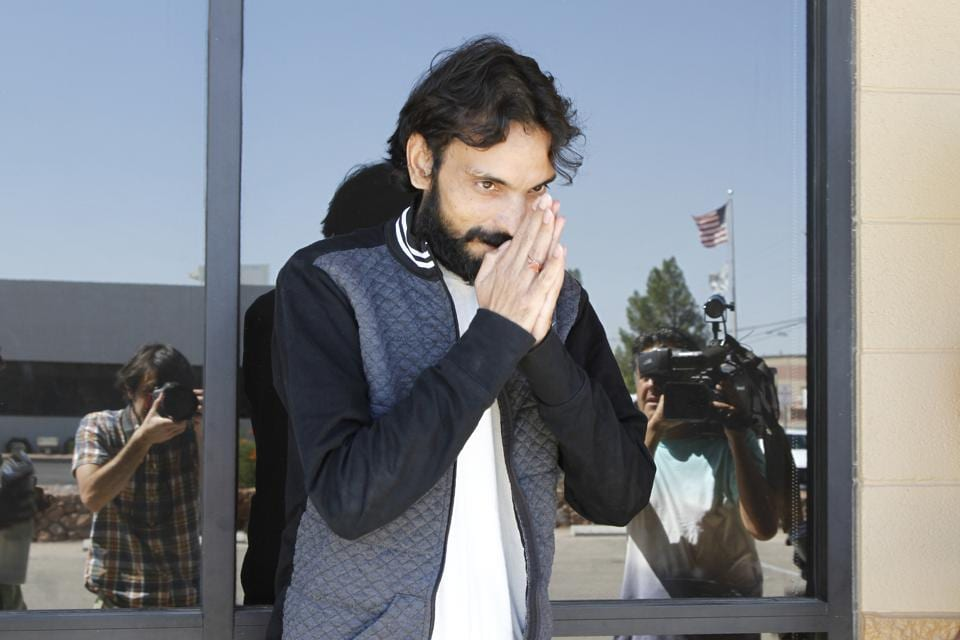 Ajay Kumar greets reporters and supporters after being released on bond from Immigrations and Customs Enforcement in El.