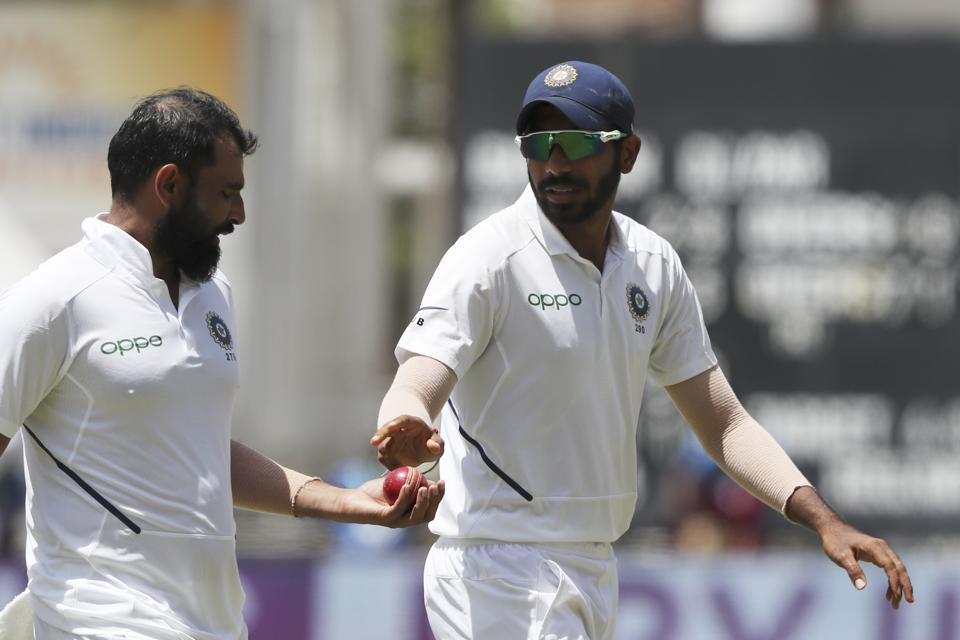India's Jasprit Bumrah, right, gives the ball to Mohammed Shami