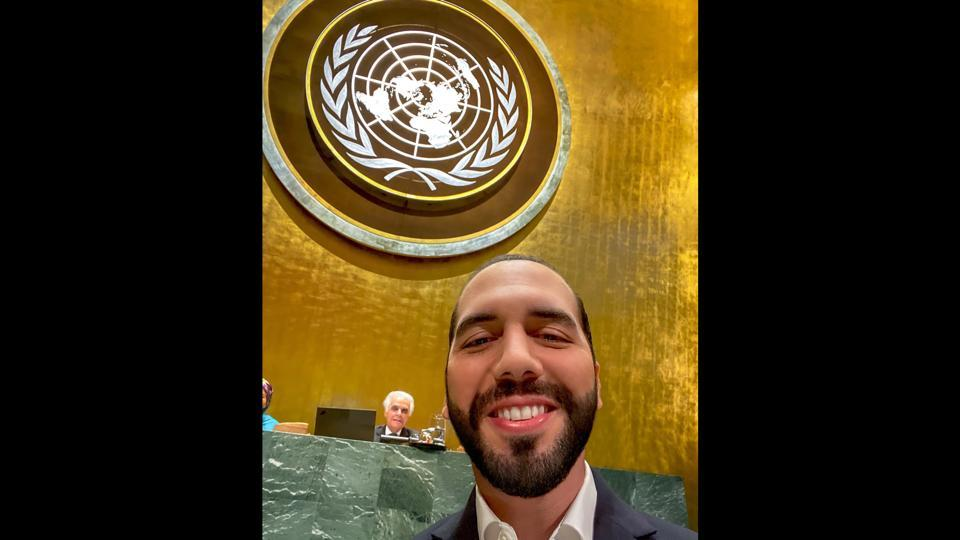 In this photo from the Twitter account of El Salvador's President Nayib Bukele, Bukele smiles as he poses for a selfie during his address to the 74th session of the United Nations General Assembly at U.N headquarters, Thursday, Sept. 26, 2019. (Nayib Bukele via AP)