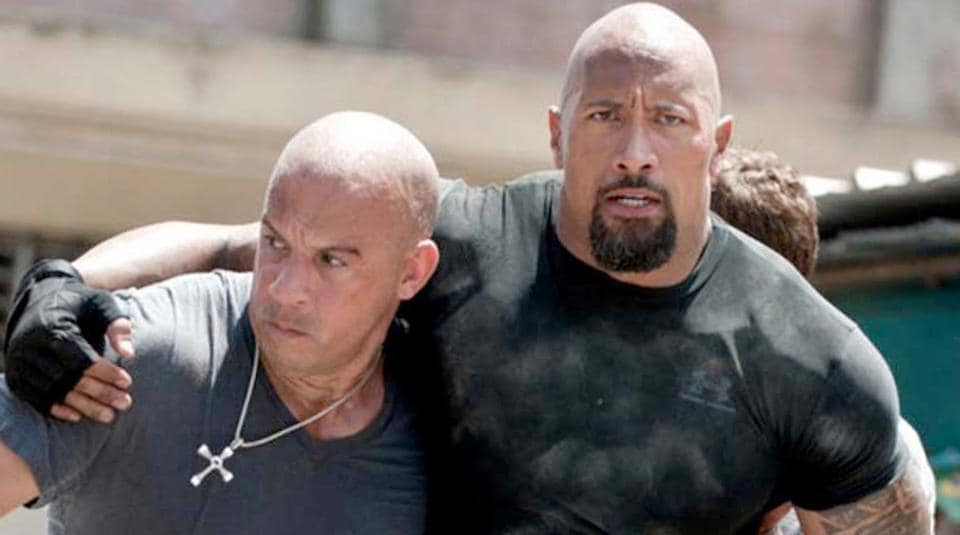 Dwayne Johnson and Vin Diesel in a still from Fast Five.