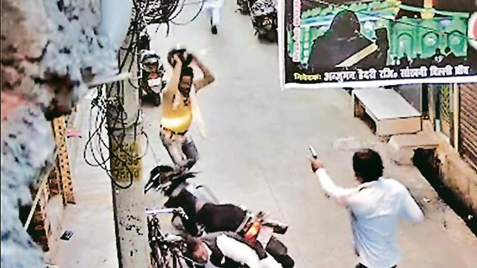 A video grab shows an armed man opening fire at a 54-year-old man in northeast Delhi's Brahmpuri on Thursday.