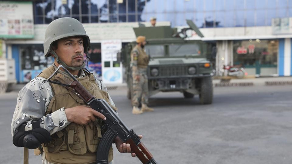 Afghan soldiers stand guard near a polling station in Kabul, Afghanistan.
