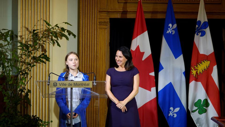 Climate change teen activist Greta Thunberg speaks as she receives the key to the city from Montreal Mayor Valerie Plante after a climate strike march in Montreal, Quebec, Canada.