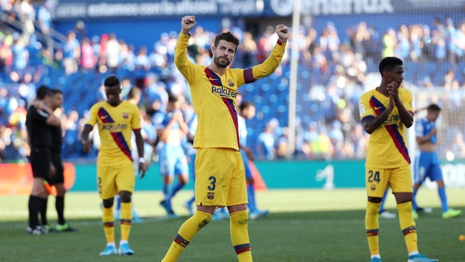 Barcelona's Gerard Pique celebrates after the match.