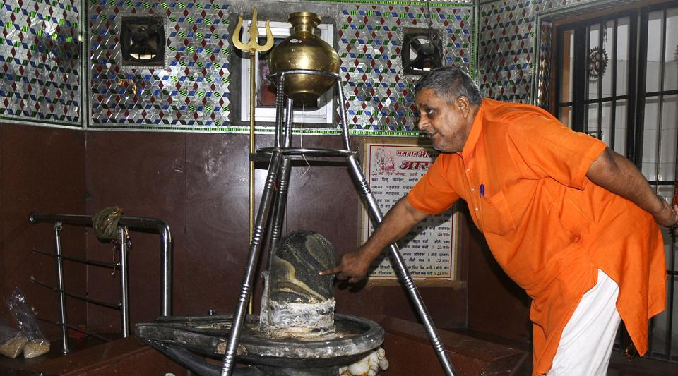 The accused used a pair of pliers to remove the silver-coating on the shivling. They also stole the silver snake covering it.
