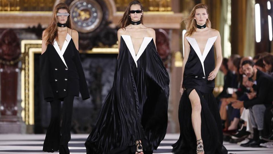 Models wear creations as part of the Balmain Ready To Wear Spring-Summer 2020 collection, unveiled during the fashion week, in Paris, Friday, Sept. 27, 2019. (AP Photo/Thibault Camus)
