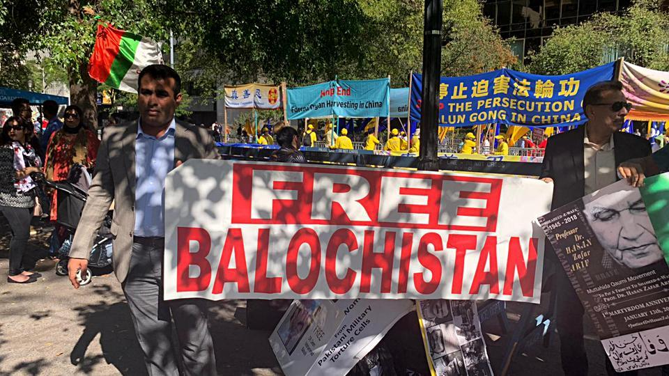 People hold a banner of 'Free Balochistan' during a protest, outside U.N. headquarters in New York.