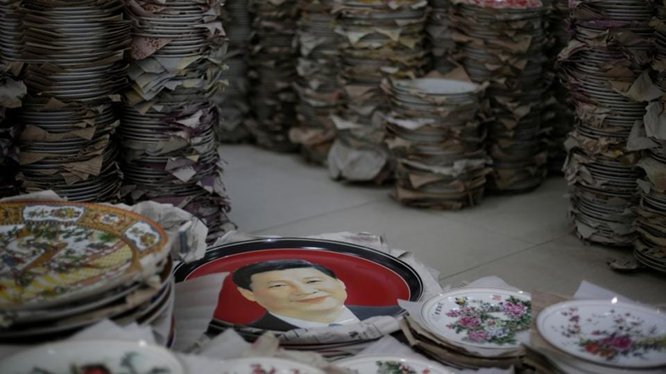 "A Jingdezhen shopowner surnamed Jiang who sells commemorative plates featuring Xi says they cannot be found on Taobao.com, China's biggest e-commerce platform. The party has to tread a fine line in promoting its top leader ""without encouraging the perception of cultishness or allowing excessive commodification of his image,"" said David Bandurski, a co-founder of the China Media Project, a research, fellowship and exchange program focusing on Chinese media at Hong Kong University. (Jason Lee / REUTERS)"