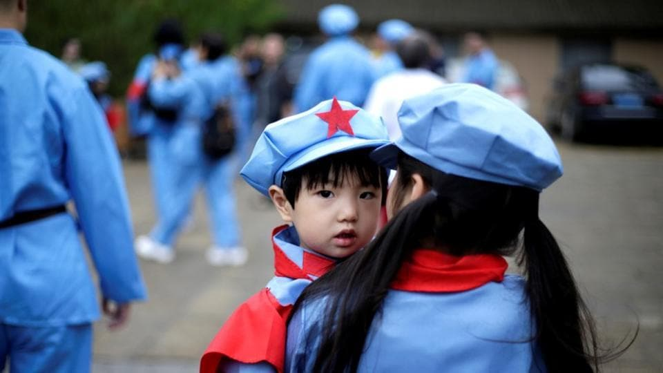 Children dressed in replica uniforms of Red Army are seen at a revolutionary site in Yanan. The city saw 50.59 million tourists in 2017, an increase of 26 percent from the year before, according to China's official Xinhua news agency. (Jason Lee / REUTERS)