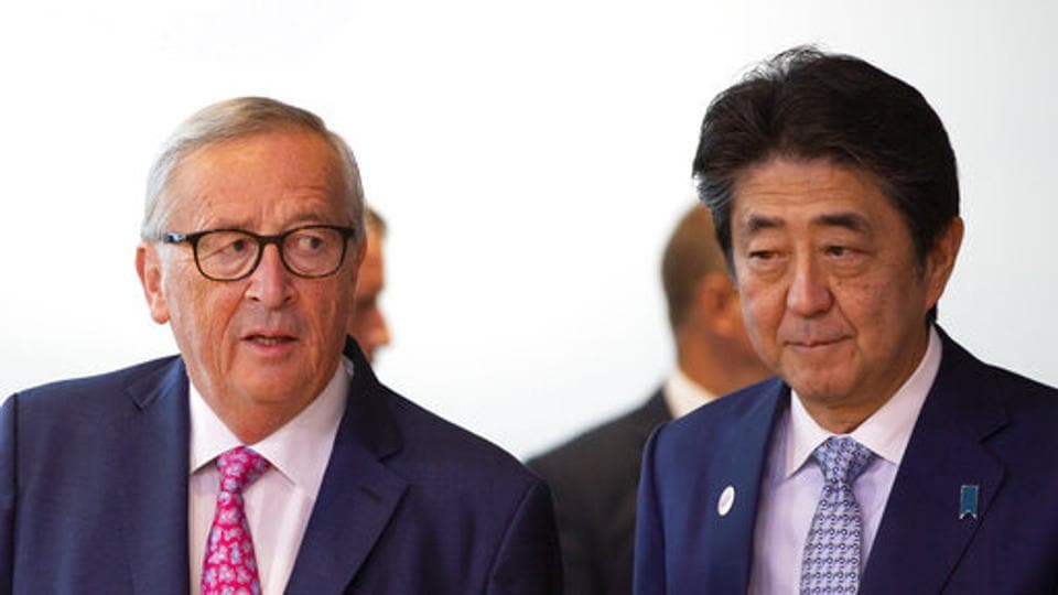 Japan's Prime Minister Shinzo Abe, right, and European Commission President Jean-Claude Juncker arrive for a meeting at EU headquarters in Brussels, Friday, Sept. 27, 2019. (AP Photo/Virginia Mayo)