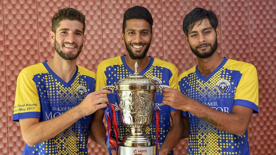 Real Kashmir FC players holding second division league trophy in New Delhi on June 3, 2018.