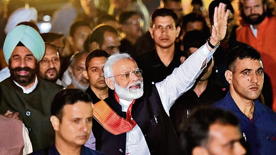 PM Narendra Modi, back from his US visit, waves at a crowd outside the Palam Technical Airport in New Delhi on Saturday.