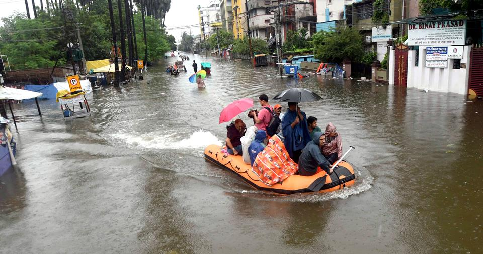 A State Disaster Response Force (SDRF) team rescues people from a flooded locality in Patna. As many as 18 National Disaster Response Force teams have also been deployed across Bihar state after heavy rainfall battered the state. (ANI Photo)