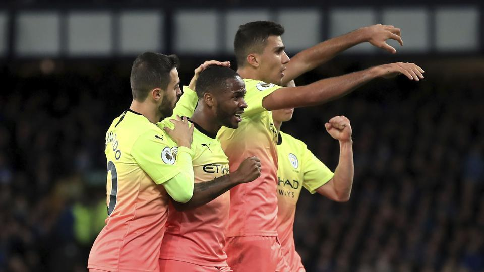 Manchester City's Raheem Sterling, centre, celebrates scoring his side's third goal of the game against Everton during their English Premier League soccer match at Goodison Park in Liverpool, England, Saturday Sept. 28, 2019.