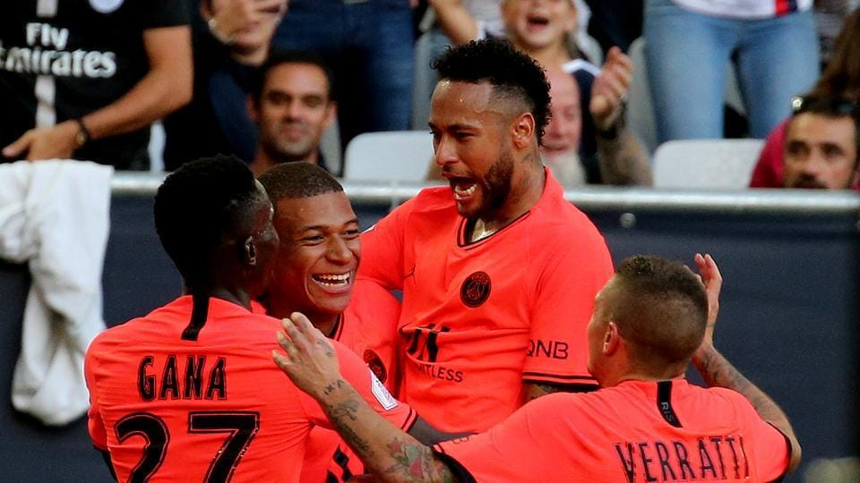 PSG Neymar, center, and Mbappe celebrate after scoring during the French League One soccer match between Bordeaux