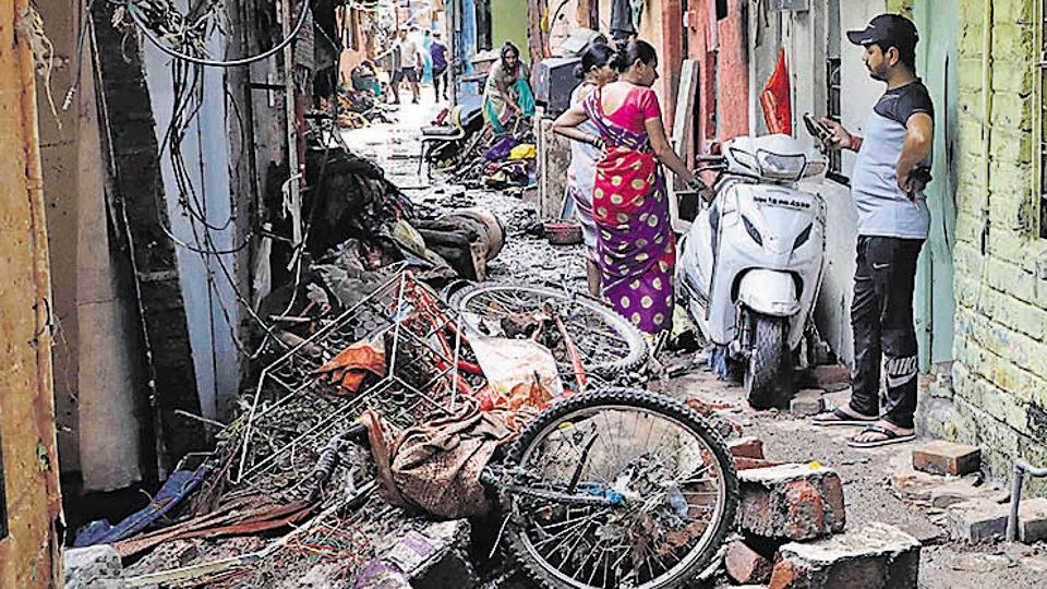 residents of the Tangewala colony clean their homes on Friday.