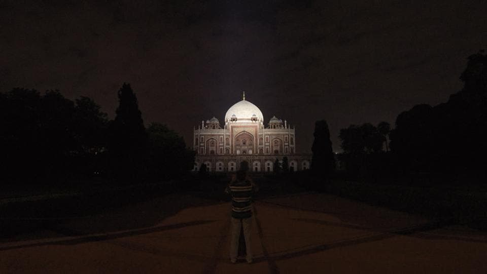 "A person takes photos at Humayun's Tomb. There is still much enthusiasm for the move. ""People are looking forward to the ambience created by the illuminated monuments and it's a treat for those wanting to click photographs,"" Abu Sufiyan, who conducts heritage walks in Old Delhi said. Viswanath added that it's a great idea to encourage night tourism, particularly in the summers. ""Why should we get stuck at our homes after 7pm,"" she asked. (Amal KS / HT Photo)"